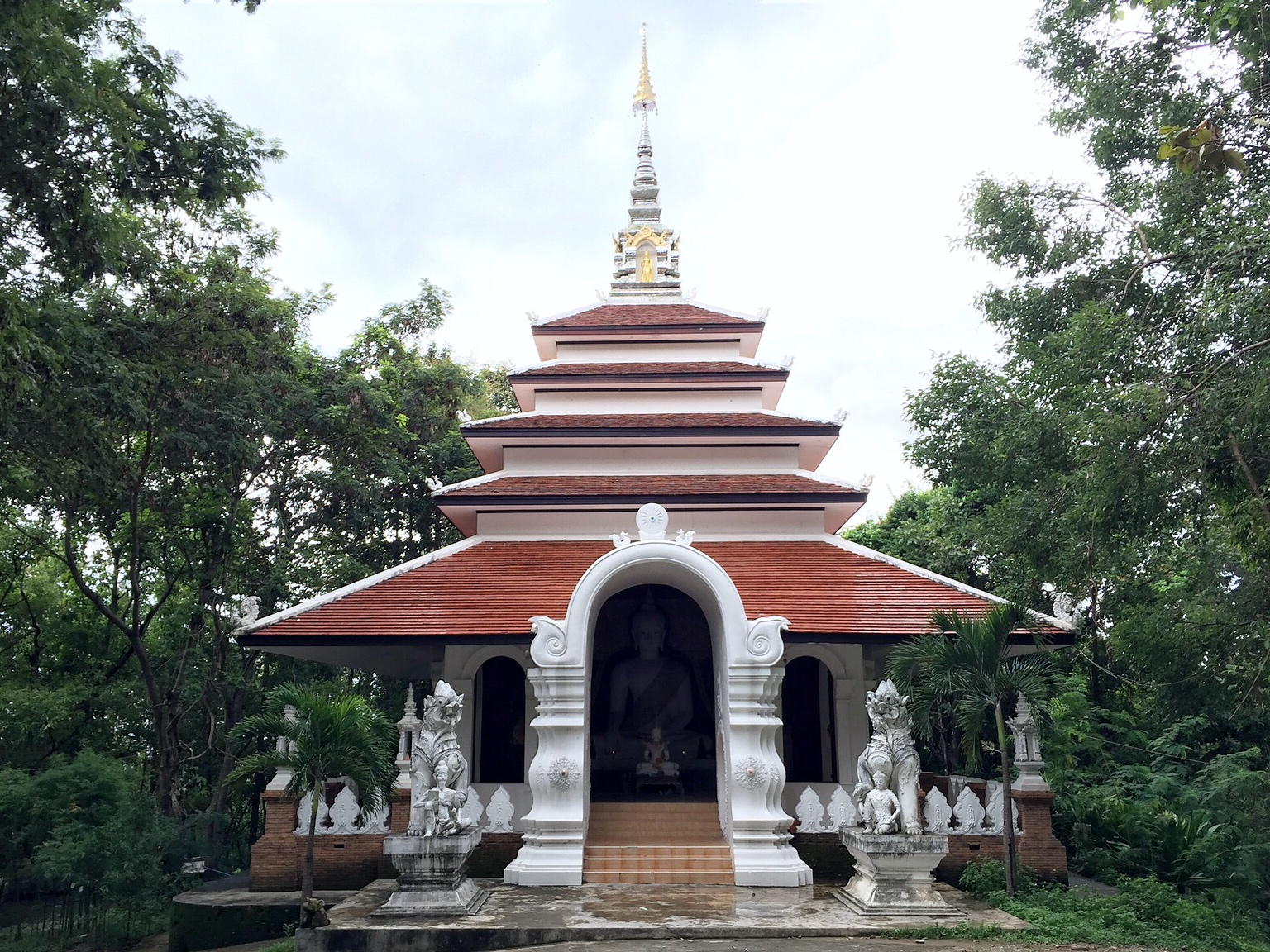 thai temple in the middle of the jungle